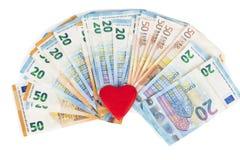 Coeur rouge avec l'euro l'euro note la réflexion argent d'amour Photographie stock libre de droits