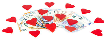 Coeur rouge avec l'euro l'euro note la réflexion argent d'amour Images stock