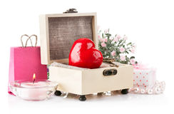 Coeur rouge avec la clé et cadeau dans le cadre Photo stock
