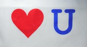 Coeur rouge avec la lettre u Photographie stock libre de droits