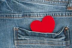 Coeur rouge dans la poche Photos libres de droits