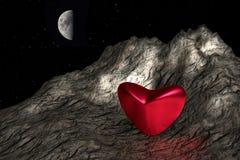Coeur rouge dans la terre en friche Photographie stock libre de droits