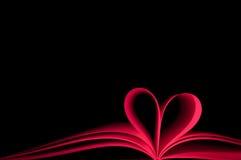 Coeur rouge de livre et de forme Photos stock