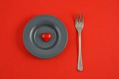 Coeur rouge de plaque Photo stock