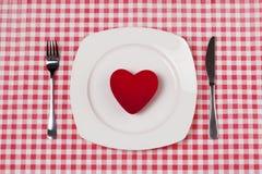 Coeur rouge de plaque Photos stock