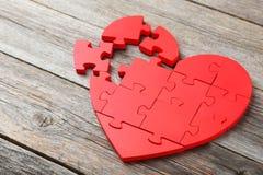 Coeur rouge de puzzle Photos stock