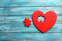Coeur rouge de puzzle Images stock