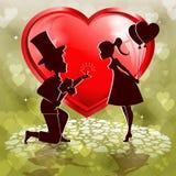 Coeur rouge, silhouette d'un garçon et fille Images stock