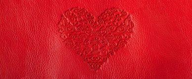 coeur rouge sur la peau rouge Image stock