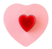 Coeur rouge sur le coeur rose Images libres de droits