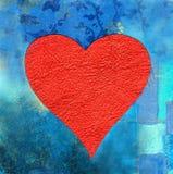 Coeur rouge sur le fond bleu Photos libres de droits
