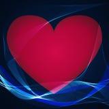 Coeur rouge sur un fond bleu Photographie stock