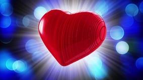 Coeur rouge sur un fond de bokeh Photo stock