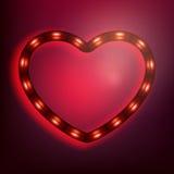 Coeur rougeoyant de néon sur le fond rouge ENV 10 Photo libre de droits