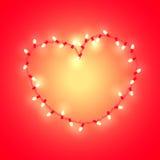 Coeur stylisé fait de guirlande rougeoyante Images libres de droits