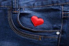 Coeur sur des jeans Photographie stock