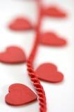 Coeur sur l'orientation d'étroit de corde Images stock