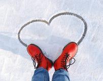 Coeur sur la neige Photos stock
