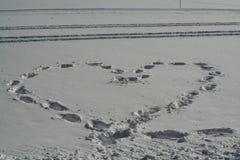 Coeur sur la neige Photo stock