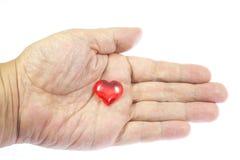 Coeur sur la paume Photos stock