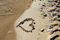 Coeur sur la plage Photo stock