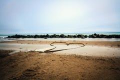 Coeur sur la plage Photo libre de droits