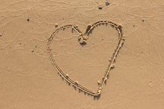 Coeur sur la plage de sable Image libre de droits