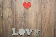 Coeur sur la table en bois Photographie stock libre de droits
