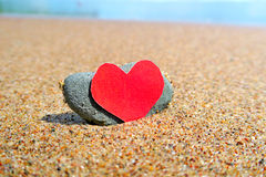 Coeur sur le bord de la mer Photographie stock