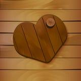 Coeur sur le fond en bois Photos stock