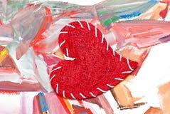 Coeur sur le fond fabriqué à la main d'aquarelle Photographie stock