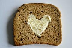 Coeur sur le pain Images stock