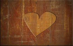 Coeur sur le panneau en bois Photo stock