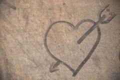 Coeur sur le plancher poussiéreux Image libre de droits