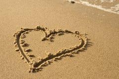 Coeur sur le sable Photo stock