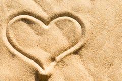 Coeur sur le sable Photographie stock