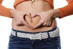 Coeur sur un estomac Images stock