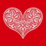 Coeur sur un fond rouge à la Saint-Valentin Photographie stock libre de droits