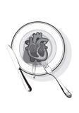 Coeur sur un plat images stock
