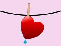 Coeur sur une chaîne de caractères Images libres de droits