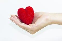 Coeur sur une main Photo stock