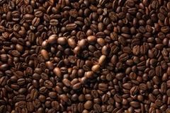 Coeur symbolique des grains de café Images libres de droits