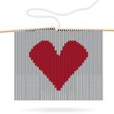 Coeur tricoté. Carte de Saint Valentin Photos stock