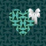 Coeur vert avec un arc blanc Image libre de droits