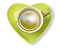Coeur vert de tasse de tisane Photos libres de droits