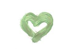 Coeur vert sur un fond blanc, peint avec la peinture à l'huile Images libres de droits