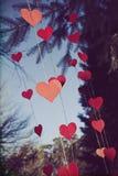 Coeurs évalués par couleur soufflant dans le vent Photo libre de droits