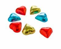 Coeurs colorés de chocolat sur le fond blanc d'isolement Images libres de droits