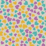 Coeurs colorés de griffonnage sur le fond de couleur photo libre de droits