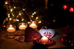 Coeurs, décorations et lumières de Noël Photos stock
